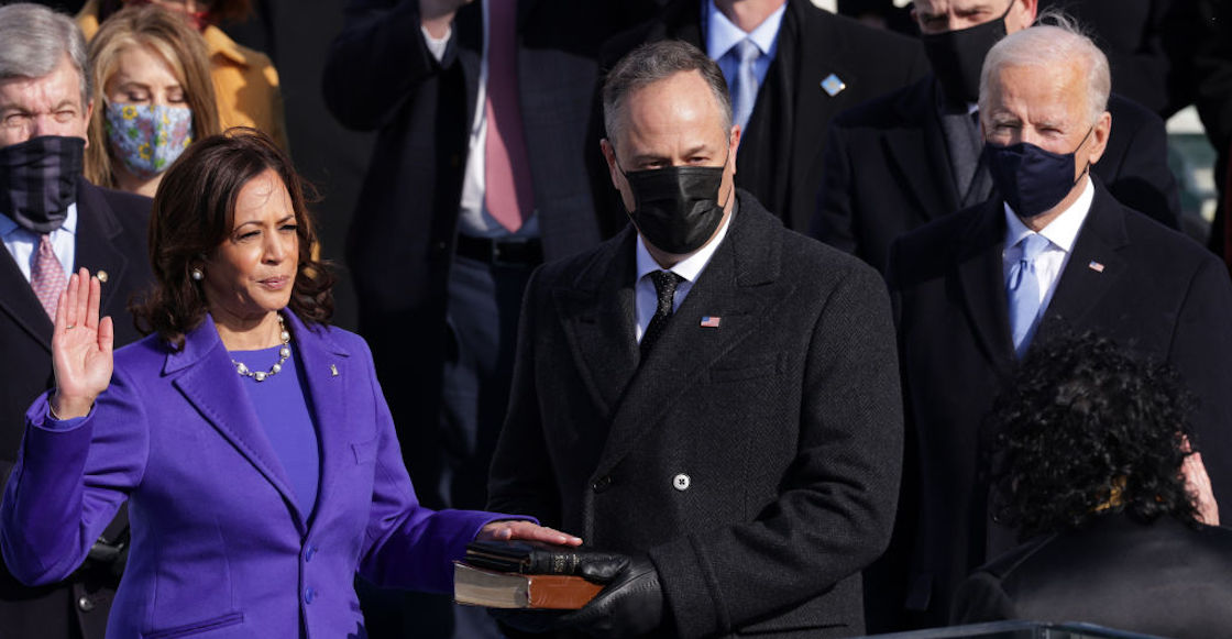 WASHINGTON, DC - JANUARY 20:  Kamala Harris is sworn in as U.S. Vice President as her husband Doug Emhoff and President Elect Joe Biden look on at the inauguration of U.S. President-elect Joe Biden on the West Front of the U.S. Capitol on January 20, 2021 in Washington, DC.  During today's inauguration ceremony Joe Biden becomes the 46th president of the United States. (Photo by Alex Wong/Getty Images)